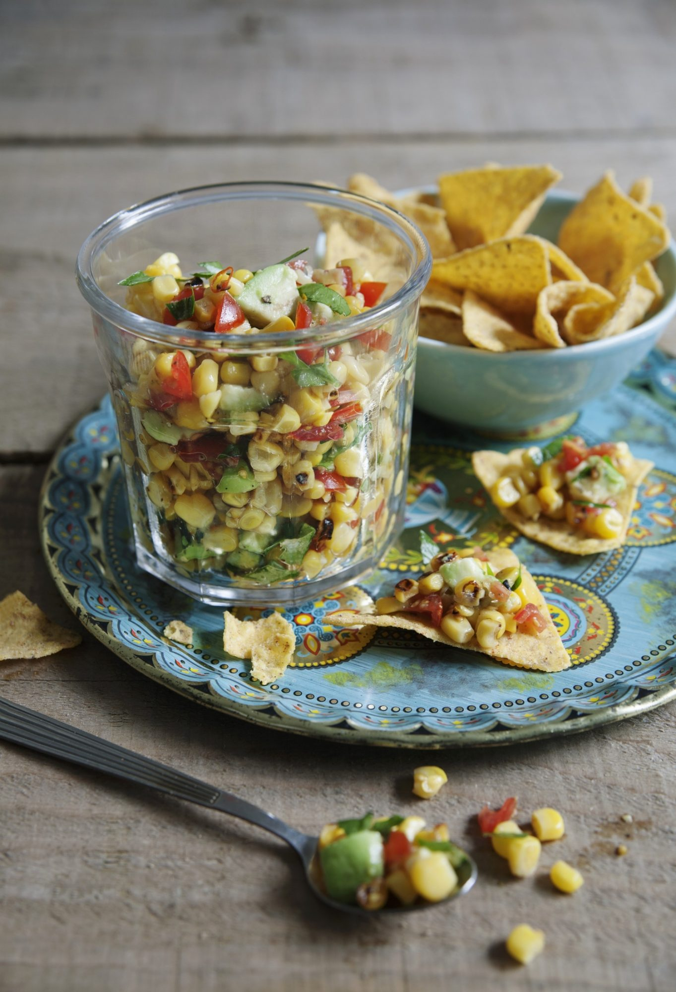 Sweetcorn and avocado salsa with limes and tomatoes.jpg