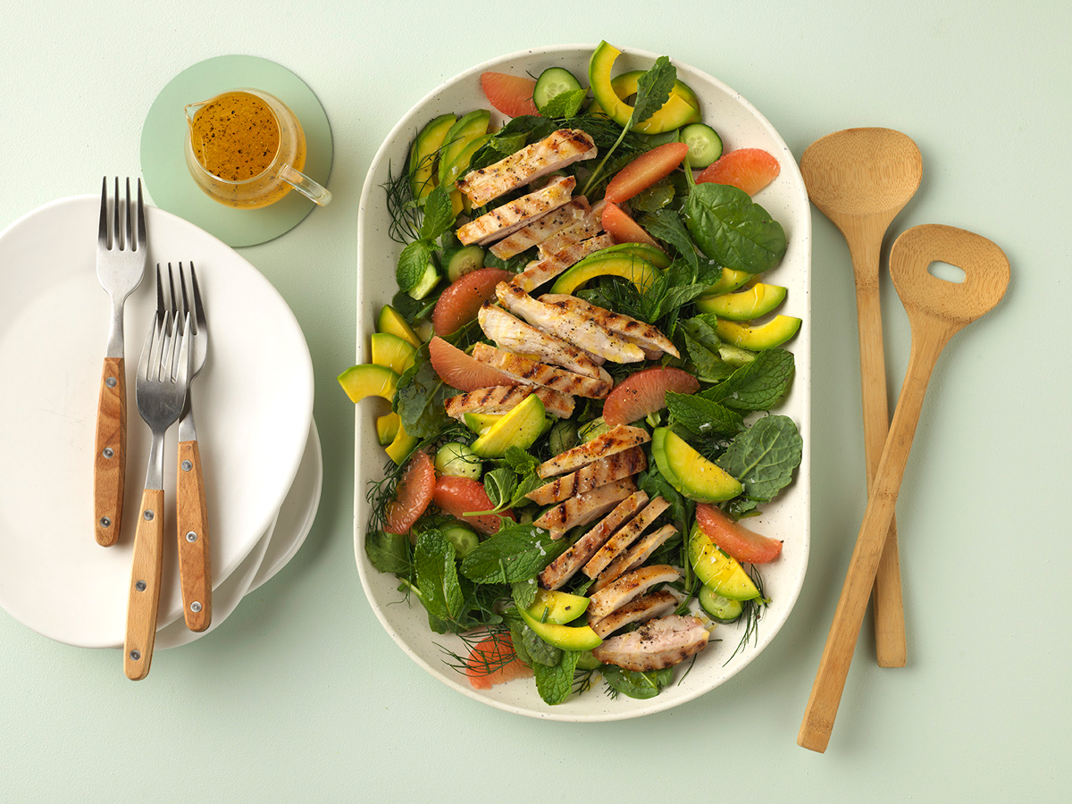 Avocado, grilled chicken and pink grapefruit salad