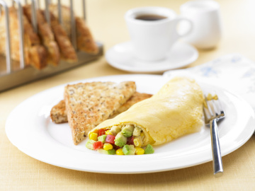 Avocado, corn and tomato omelette